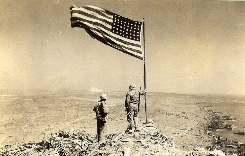 The Battle of Iwo Jima and the First Flag Raising on Mount Suribachi <br />(Yank Magazine, 1945)