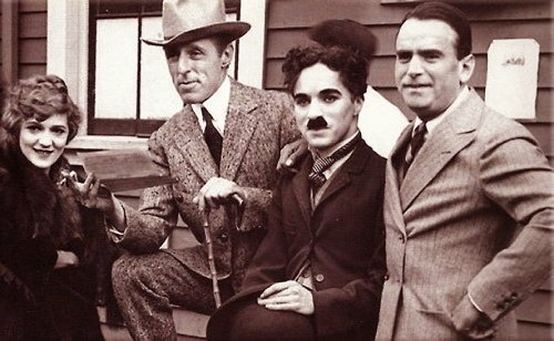 Charlie Chaplin Joins With Pickford, Fairbanks and Griffith to Form United Artists<br>  <br />(Film Daily, 1939)